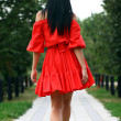 Beautiful woman in red dress — Stock Photo #50810981
