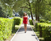 Beautiful woman in red dress  — Stock Photo