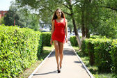 Sexy young woman in red dress  — Stock Photo