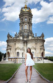 Church of the Blessed Virgin in Dubrovitsy and young woman — Stock Photo