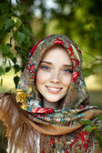 Beauty woman in the national patterned scarf — Stock Photo