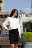 Business woman with blue mirrored sunglasses — Stock Photo