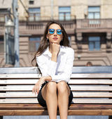 Beautiful business woman sitting on a bench  — Stock fotografie