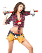 Sexy brunette in a plaid shirt — Stockfoto