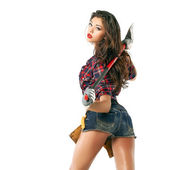 Sexy brunette with an ax in his hand — Stock Photo
