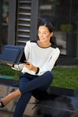 Young businesswoman working on a laptop — Stock Photo