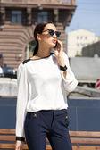 Beautiful business woman calling by phone — Stock Photo