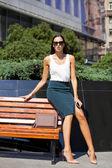 Beautiful business woman sitting on a bench  — Stock Photo