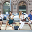 Business people sitting on a bench — Stock Photo #51174913