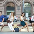 Business people sitting on a bench — Stock Photo #51174921