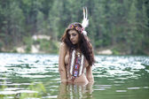 Young woman in costume of American Indian — Stock Photo
