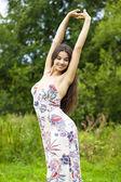 Beautiful young woman in colorful dress — Foto de Stock