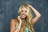 Portrait of a beautiful blonde girl with luxuriant hair — Stock Photo