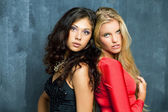 Beautiful young women on a dark background — Stock Photo