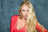 Beautiful young woman in fashion red dress — Stock Photo