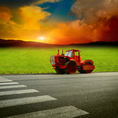 Asphalt machine near by field — Stock Photo