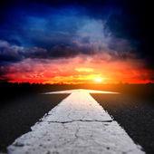 Asphalt road at sunset — Stock Photo