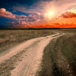Ground road at the sunset — Stock Photo