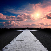 Asphalt road at sunset — Stock Photo