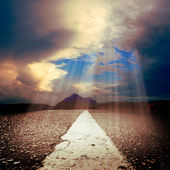 Asphalt road with sun rays — Stock Photo