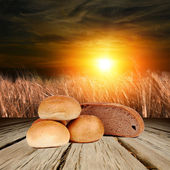 Bread on the wooden background — Stock Photo