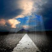 Asphalt road with sun rays — Stock Photo
