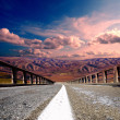 Asphalt road with mountians - Stock fotografie