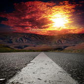 Asphalt road with mountians — Stock Photo