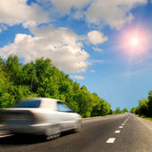 Grey car on the road — Stock Photo