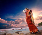 Woman on coast — Stock Photo