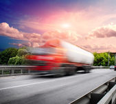 Red truck on the bridge — Stock Photo
