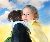 Little girl with mother on nature — Stock Photo
