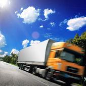 Yellow truck on the asphalt road — Stock Photo