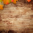 Wooden background with the leaves — Stock Photo