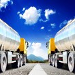 Big trucks on asphalt road — Stock Photo #38974433
