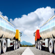 Big trucks on asphalt road — Stock Photo #38974437