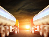 Big trucks on the asphalt road — Foto Stock