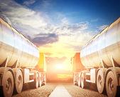Big trucks on the asphalt road — Stock Photo