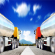Big trucks on asphalt road — Stock Photo #40076535
