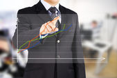 Image of male hand pointing at business graphics — Foto de Stock