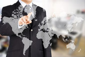 Businessman with map — Stock Photo