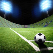 Míč a fotbalové pole — Stock fotografie