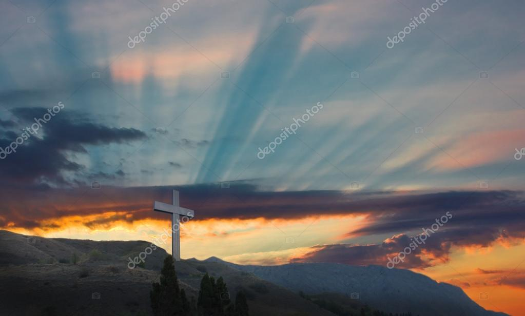 Metallic cross on a background an ascending sun    Stock Photo #12471621