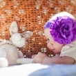 Baby girl playing with toy — Stock Photo