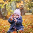 Little girl portrait in autumn park — Stock Photo
