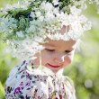 Portrait of little girl in a field of flowers — Stock Photo