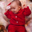 Baby girl in christmas wear — Stock Photo #30848791