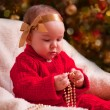 Baby girl in christmas wear — Stock Photo #31494179
