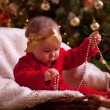 Baby girl in christmas wear — Stock Photo #31494183
