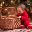 Baby girl in christmas wear — Stock Photo #31526921